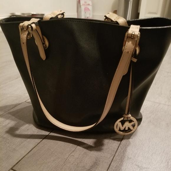 Michael Kors Handbags - Michael Kors purse black  w/ tan straps